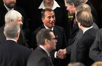 House Speaker-desigante John Boehner of Ohio greets House members during the first session of the 112th Congress, on Capitol Hill in Washington, Wednesday, Jan. 5, 2011.  (AP Photo/Charles Dharapak) By Charles Dharapak