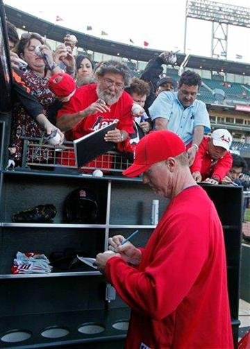 St. Louis Cardinals hitting coach Mark McGwire signs autographs at AT&T Park before their baseball game against the San Francisco Giants in San Francisco, Friday, April 23, 2010.  (AP Photo/Eric Risberg) By Eric Risberg