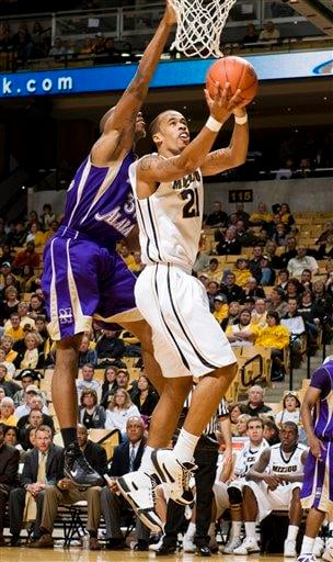 Missouri's Laurence Bowers, right shoot past North Alabama's Marcus Landry, left, during the second half of an NCAA college basketball game Wednesday, Jan. 5, 2011, in Columbia, Mo. Missouri won the game 98-58.  (AP Photo/L.G. Patterson) By L.G. Patterson