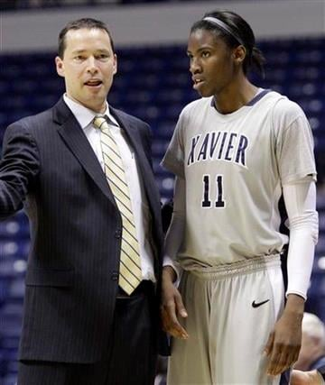 Xavier head coach Kevin McGuff talks with forward Amber Harris (11) in the second half of an NCAA college basketball game, Wednesday, Jan. 5, 2011, in Cincinnati. Harris scored 16 points in the game won by Xavier 83-51. (AP Photo/Al Behrman) By Al Behrman