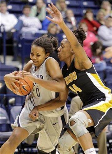 Xavier guard Tyeasha Moss (0) drives against Missouri forward Shakara Jones (44) in the first half of an NCAA college basketball game, Wednesday, Jan. 5, 2011, in Cincinnati. (AP Photo/Al Behrman) By Al Behrman