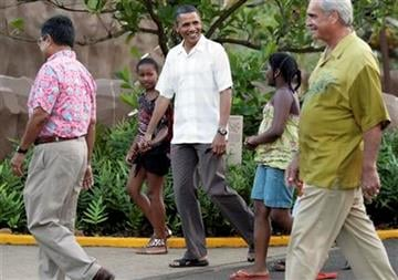 President Barack Obama walks with his daughter Sasha Obama, second from left, and other family friends through Honolulu Zoo in Honolulu, Monday, Jan. 3, 2011. (AP Photo/Carolyn Kaster) By Carolyn Kaster