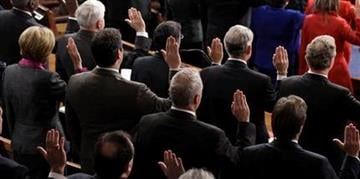House Members take their oath of office during the first session of the 112th Congress, on Capitol Hill in Washington, Wednesday, Jan. 5, 2011.  (AP Photo/Charles Dharapak) By Charles Dharapak