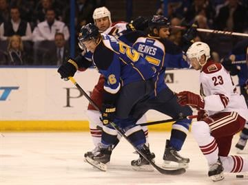 St. Louis Blues Dmitrij Jaskin of Russia passes the puck behind his back against the Phoenix Coyotes in the first period at the Scottrade Center in St. Louis on January 14, 2014.   UPI/Bill Greenblatt By BILL GREENBLATT