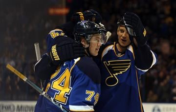 St. Louis Blues teammates skate in to congratulate T.J. Oshie (74) after he scored a goal against the Phoenix Coyotes in the first period at the Scottrade Center in St. Louis on January 14, 2014.   UPI/Bill Greenblatt By BILL GREENBLATT