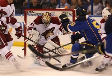 St. Louis Blues Magnus Paajarvi of Sweden pushes the puck off the pads of Phoenix Coyotes goaltender Mike Smith in the first period at the Scottrade Center in St. Louis on January 14, 2014.   UPI/Bill Greenblatt By BILL GREENBLATT