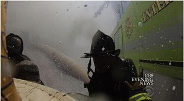 Helmet footage and video from a fire truck reveal a number of emergency workers warning others that a victim was on the ground near the jet By Sarah Heath