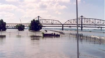 Mississippi River at Alton, Illinois—The 1993 flood south of the Missouri Highway 367 bridge near Alton. A USGS gauging station is inundated near the fence. By Belo Content KMOV