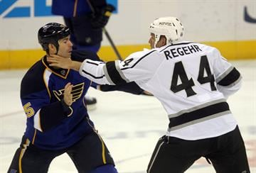 Los Angeles Kings Robyn Regehr grabs the throat of St. Louis Blues Barret Jackman as they begin to fight in the first period at the Scottrade Center in St. Louis on January 16, 2014. UPI/Bill Greenblatt By BILL GREENBLATT