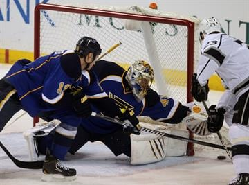 St. Louis Blues goaltender Jaroslav Halak of Slovokia pushes away a shot by Los Angeles Kings Dustin Brown in the first period at the Scottrade Center in St. Louis on January 16, 2014. UPI/Bill Greenblatt By BILL GREENBLATT