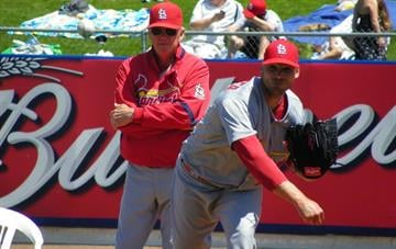 Cardinals starting pitcher Chris Carpenter warms up before Tuesday's game between the Cardinals and the Mets. By Lakisha Jackson