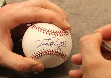 St. Louis Cardinals Trevor Rosenthal signs a baseball for a fan during the St. Louis Cardinals Winter Warm-up in St. Louis on January 18, 2014.  UPI/Bill Greenblatt By BILL GREENBLATT