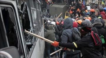 Protesters attack a riot police bus in central Kiev, Ukraine, Sunday, Jan. 19, 2014. By Elizabeth Eisele
