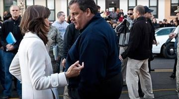 Mayor Dawn Zimmer (L) of Hoboken chats with New Jersey Governor Chris Christie (R) prior to a joint press conference on November 4, 2012 in Hoboken, New Jersey. By Elizabeth Eisele