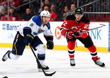 NEWARK, NJ - JANUARY 21:  Jaden Schwartz #9 of the St. Louis Blues takes the puck as Eric Gelinas #22 of the New Jersey Devils defends at Prudential Center on January 21, 2014  in Newark, New Jersey.  (Photo by Elsa/Getty Images) By Elsa