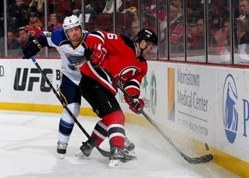 NEWARK, NJ - JANUARY 21:  Andy Greene #6 of the New Jersey Devils tries to keep the puck from Jaden Schwartz #9 of the St. Louis Blues at Prudential Center on January 21, 2014  in Newark, New Jersey.  (Photo by Elsa/Getty Images) By Elsa