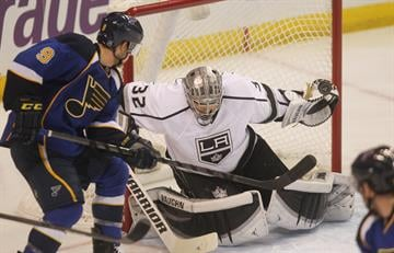 Los Angeles Kings goaltender Jonathan Quick makes a glove save on a shot by St. Louis Blues Jaden Schwartz in the third period at the Scottrade Center in St. Louis on January 16, 2014. Los Angeles won the game 4-1. UPI/Bill Greenblatt By BILL GREENBLATT