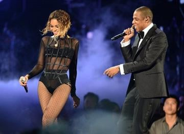 Beyonce Knowles and Jay-Z perform on stage for the 56th Grammy Awards at the Staples Center in Los Angeles, California, January 26, 2014. AFP PHOTO FREDERIC J. BROWN        (Photo credit should read FREDERIC J. BROWN/AFP/Getty Images) By FREDERIC J. BROWN