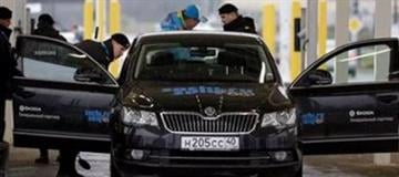Russian police officers search a vehicle at an entrance to the Sochi 2014 Olympic Winter Games park, Thursday, Jan. 23, 2014, in Sochi, Russia. The Olympics begin on Feb. 7. (AP Photo/David J. Phillip) By David J. Phillip