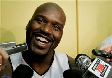 """FILE - This April 19, 2007, file photo shows Miami Heat center Shaquille O'Neal talking to the news media following a team basketball practice in Miami.  O'Neal says on Twitter that he's """"about to retire."""" (AP Photo/Lynne Sladky, File) By Lynne Sladky"""