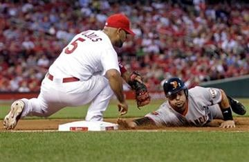San Francisco Giants' Cody Ross just beats the tag from St. Louis Cardinals first baseman Albert Pujols as he dive back to first in the fourth inning of a baseball game, Wednesday, June 1, 2011 in St. Louis.(AP Photo/Tom Gannam) By Tom Gannam