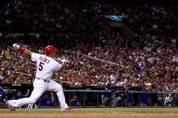 St. Louis Cardinals' Albert Pujols watches his two-run home run during the fifth inning of a baseball game against the Chicago Cubs Friday, June 3, 2011, in St. Louis. (AP Photo/Jeff Roberson) By Jeff Roberson