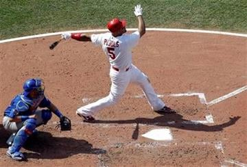 St. Louis Cardinals' Albert Pujols, right, hits a two-run home run during the fourth inning of a baseball game as Chicago Cubs catcher Geovany Soto looks on, Saturday, June 4, 2011, in St. Louis. (AP Photo/Jeff Roberson) By Jeff Roberson