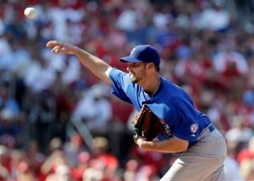 Chicago Cubs starting pitcher Randy Wells throws during the sixth inning of a baseball game against the St. Louis Cardinals, Saturday, June 4, 2011, in St. Louis. (AP Photo/Jeff Roberson) By Jeff Roberson