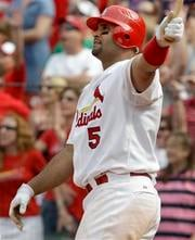 St. Louis Cardinals' Albert Pujols watches his walkoff home run during the 10th inning of a baseball game against the Chicago Cubs, Sunday, June 5, 2011, in St. Louis. The Cardinals won 3-2. (AP Photo/Jeff Roberson) By Jeff Roberson