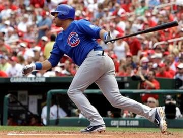 Chicago Cubs' Aramis Ramirez hits a two-run double during the fourth inning of a baseball game against the St. Louis Cardinals, Sunday, June 5, 2011, in St. Louis. (AP Photo/Jeff Roberson) By Jeff Roberson