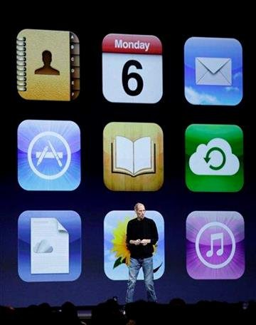 Apple CEO Steve Jobs shows icons of all the new applications for iCloud at the Worldwide Developers Conference in San Francisco, Monday, June 6, 2011. (AP Photo/Marcio Jose Sanchez) By Marcio Jose Sanchez
