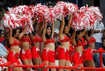 Cheerleaders entertain the crowd during the Twenty20 international cricket match between India and the West Indies in Port of Spain, Trinidad, Saturday June 4, 2011. (AP Photo/Andres Leighton) By Andres Leighton