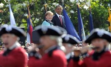President Barack Obama and German Chancellor Angela Merkel look on during an arrival ceremony on the South Lawn of the White House in Washington, Tuesday, June 7, 2011. (AP Photo/Susan Walsh) By Susan Walsh