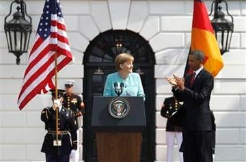President Barack Obama applauds after German Chancellor Angela Merkel spoke on the South Lawn at the White House in Washington, Tuesday, June 7, 2011. (AP Photo/Charles Dharapak) By Charles Dharapak