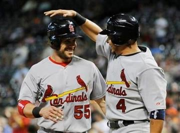 St. Louis Cardinals Skip Schumaker (55) and Yadier Molina celebrate scoring on a Jake Westbrook three-run double in the fourth inning of a baseball game against the Houston Astros Tuesday, June 7, 2011, in Houston. (AP Photo/Pat Sullivan) By Pat Sullivan