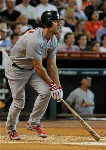 St. Louis Cardinals' Lance Berkman watches the ball go over the outfield fence for a two-run homer in the first inning of a baseball game against the Houston Astros Tuesday, June 7, 2011, in Houston. (AP Photo/Pat Sullivan) By Pat Sullivan