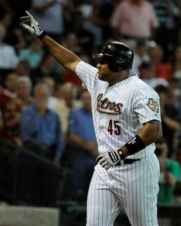 Houston Astros' Carlos Lee waves toward the fans after hitting a two-run homer against the St. Louis Cardinals in the first inning of a baseball game Tuesday, June 7, 2011, in Houston. (AP Photo/Pat Sullivan) By Pat Sullivan