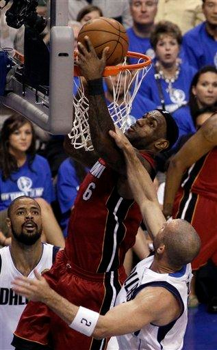 Miami Heat's LeBron James goes up for a shot past Dallas Mavericks' Jason Kidd during the first half of Game 4 of the NBA Finals basketball game Tuesday, June 7, 2011, in Dallas. (AP Photo/David J. Phillip) By David J. Phillip