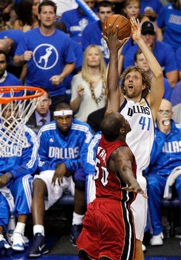 Dallas Mavericks' Dirk Nowitzk shoots over Miami Heat's Joel Anthony (50) during the first half of Game 4 of the NBA Finals basketball game Tuesday, June 7, 2011, in Dallas. (AP Photo/LM Otero) By LM Otero