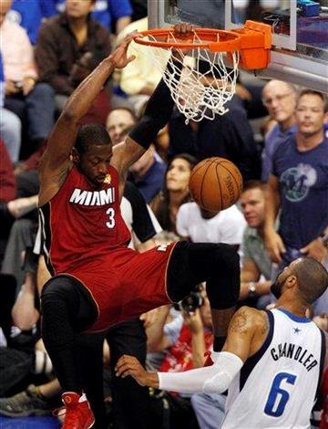 Miami Heat's Dwyane Wade (3) dunks over Dallas Mavericks' Tyson Chandler (6) during the first half of Game 4 of the NBA Finals basketball game Tuesday, June 7, 2011, in Dallas. (AP Photo/LM Otero) By LM Otero