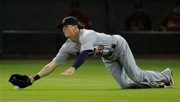 St. Louis Cardinals center fielder Colby Rasmus just misses the catch to allow Houston Astros' J.R. Towles a double in the sixth inning of a baseball game on Wednesday, June 8, 2011, in Houston. (AP Photo/Pat Sullivan) By Pat Sullivan