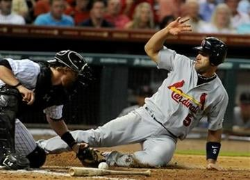 St. Louis Cardinals' Albert Pujols (5) slides in to home plate as Houston Astros catcher J.R. Towles reaches for the ball in the sixth inning of a baseball game on Thursday, June 9, 2011, in Houston. (AP Photo/Pat Sullivan) By Pat Sullivan