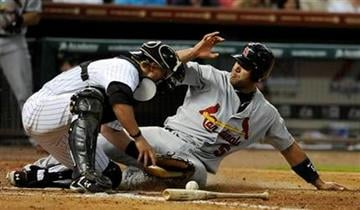 St. Louis Cardinals' Albert Pujols (5) slides in to home plate to score as Houston Astros catcher J.R. Towles reaches for the ball in the sixth inning of a baseball game on Thursday, June 9, 2011, in Houston. (AP Photo/Pat Sullivan) By Pat Sullivan