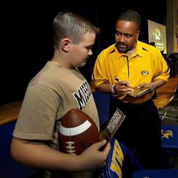 In this April 28, 2011 photo, Missouri mens basketball coach Frank Haith signs an autograph for Kade Marnin, age 12, at a Tiger Caravan event in Mendon, Mo. (AP Photo/Charlie Riedel) By Charlie Riedel