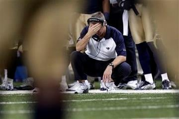 St. Louis Rams head coach Steve Spagnuolo pauses on the sidelines late in the fourth quarter of an NFL football game against the Kansas City Chiefs, Sunday, Dec. 19, 2010, in St. Louis. The Chiefs won 27-13. (AP Photo/Jeff Roberson) By Jeff Roberson