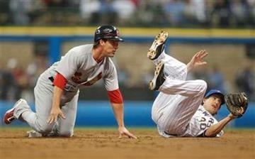 Milwaukee Brewers' Craig Counsell, right, tumbles after picking off St. Louis Cardinals' Ryan Theriot, left, at second base in the third inning of a baseball game on Friday, June 10, 2011, in Milwaukee. (AP Photo/Jeffrey Phelps) By Jeffrey Phelps
