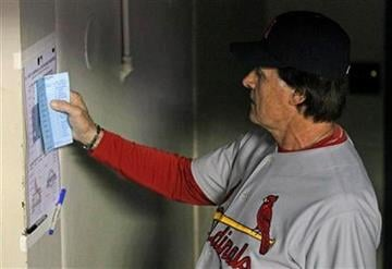 St. Louis Cardinals manager Tony La Russa checks his baseball game lineup against the Milwaukee Brewers, Friday, June 10, 2011, in Milwaukee.  La Russa was managing his 5,000th game on Friday. AP Photo/Jeffrey Phelps) By Jeffrey Phelps