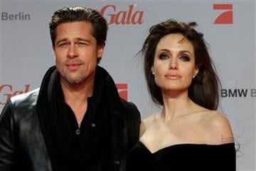 "U.S. actors Angelina Jolie, right, and Brad Pitt arrive at the European premier of the movie ""The Tourist"" in Berlin on Tuesday, Dec. 14, 2010. (AP Photo/Markus Schreiber) By Markus Schreiber"