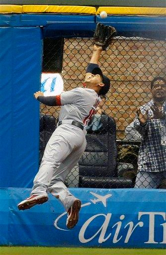 St. Louis Cardinals' Jon Jay makes a leaping catch on a ball hit by Milwaukee Brewers' Casey McGehee in the fourth inning of a baseball game on Saturday, June 11, 2011, in Milwaukee.  (AP Photo/Jeffrey Phelps) By Jeffrey Phelps
