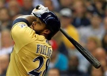 Milwaukee Brewers' Prince Fielder watches his home run against St. Louis Cardinals pitcher Chris Carpenter in the second inning of a baseball game on Saturday, June 11, 2011, in Milwaukee. (AP Photo/Jeffrey Phelps) By Jeffrey Phelps